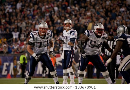BOSTON - OCTOBER 16: Quarterback Tom Brady, No 12, prepares to throw pass at Gillette Stadium, New England Patriots vs. Dallas Cowboys on October 16, 2011 in Foxborough, Boston, MA