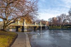 Boston Public Garden Bridge in Boston Public Garden with blue sky background in winter.