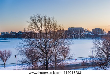 Boston's Charles River frozen with cross-country skiier