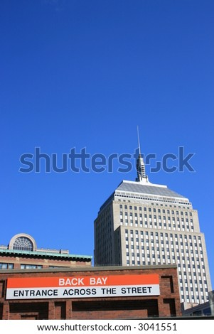 Boston's Old John Hancock Building and the entrance to the Back Bay T (subway) stop.