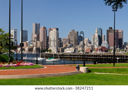 Boston skyline and harbor. Harborwalk renovation and park in foreground, cityscape in the background.
