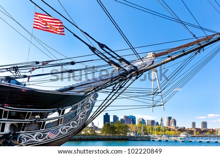 Boston skyline framed by the USS Constitution, oldest battleship in American history