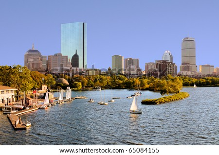 Boston skyline from Cambridge. Sailboats in Charles River, around the Esplanade