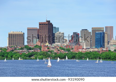 Boston skyline over Charles River with sailing boat.