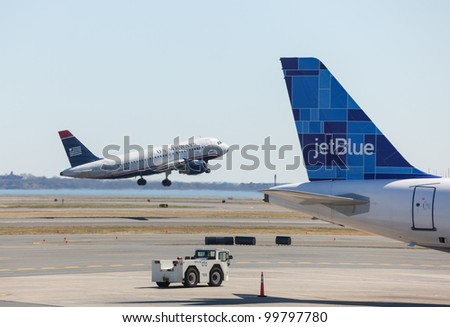 BOSTON, USA - MARCH 22: US Airways Airbus A319 takes off on March 22, 2012. Logan Airport is the largest in New England - stock photo