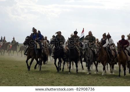 BOSZTORPUSZTA, HUNGARY - AUGUST 13 : Medieval Hungarian historical show on 13, August 2011. Bosztorpuszta, Hungary. Hungarian traditional horsemen