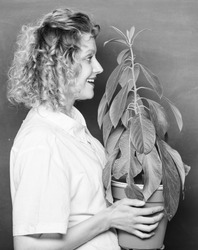Botanical expert. Botany education. Botany is about plants flowers and herbs. Woman chalkboard background carry plant in pot. Take good care plants. Florist concept. Botany and biology lesson.