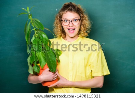 Botany and nerd concept. Woman school teacher chalkboard background carry plant in pot. Take good care plants. Botany and biology lesson. Botanical expert. Botany education. Greenery benefits. #1498115321
