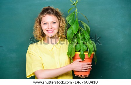 Botany is about plants flowers and herbs. Woman chalkboard background carry plant in pot. Take good care plants. Botany and biology lesson. Botanical expert. Botany education. Florist concept. #1467600410