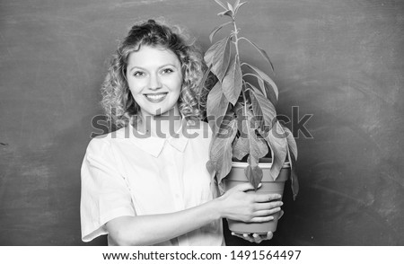 Botany is about plants flowers and herbs. Woman chalkboard background carry plant in pot. Take good care plants. Botany and biology lesson. Botanical expert. Botany education. Florist concept.