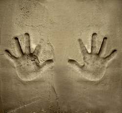 both hands print on cement mortar wall with shadow relief