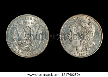 Both Sides of an 1885  Dollar Liberty Head on the Obverse, Eagle With Outstretched Wings on the Reverse. Isolated on Black