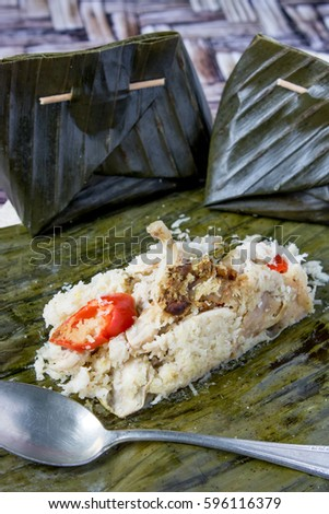 Botok Ayam - Indonesian Traditional Cuisine. Chicken wrap with grated coconut  herbs, vegetables and steamed in Banana leaf