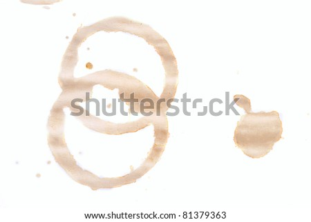 bottle and a glass of wine on a brown background