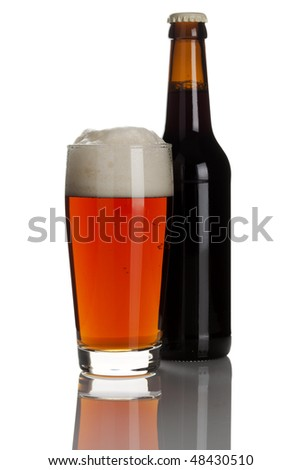 bottle and glass of ale isolated on white