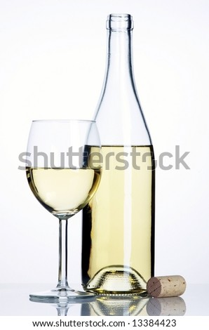 Bottle and glass of white wine with cork
