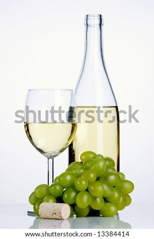 Bottle and glass of white wine with grapes and cork on white background - stock photo