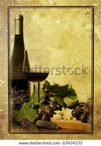 Bottle and glass of wine with grapes and cheese