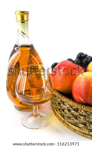 bottle and glass with wine against fruits