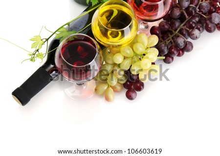 bottle and glasses of wine and ripe grapes isolated on white