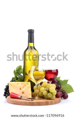 bottle and glasses of wine, assortment of grapes and cheese isolated on white