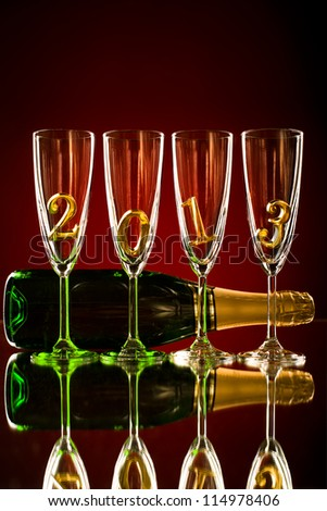 bottle  champagne with four glass goblet and  numeral 2013,  beautiful celebrations  New Year concept photo