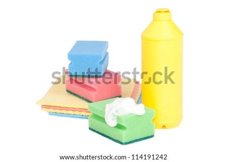 Bottle, colorful sponges isolated on white background