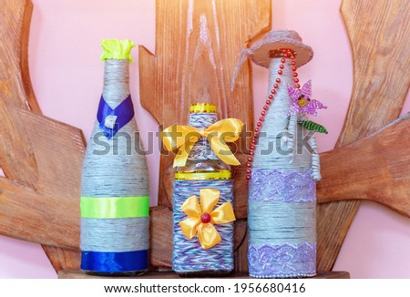 Bottle decorated with a rope. Handmade. Stock photo ©