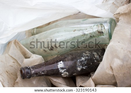 bottle glass in a recycle bin mound, garbage #323190143