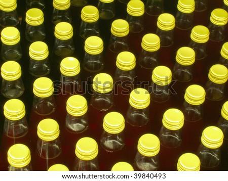Bottle golden caps. Lots of glass bottles.