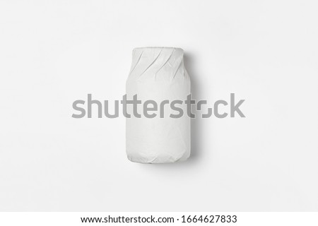 Bottle(jar) wrapped in white paper on white background.Mockup.High resolution photo. Stock photo ©