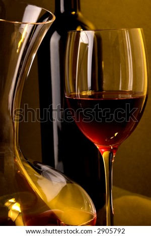 bottle, jug and glass of red wine