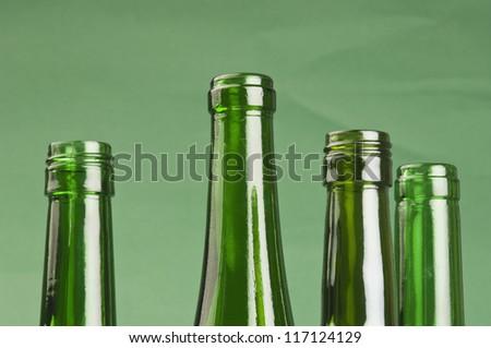 Bottle necks of empty wine bottles