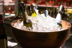bottle of alcohol beverage in ice bucket