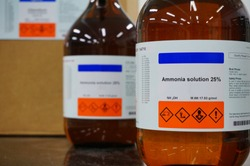 Bottle of Ammonia solution 25%, Ammonium hydroxide, NH4OH with Properties information and its chemical hazard warning symbols. Corrosive, Inhalation,Toxic warning, Hazardous to the Environment.