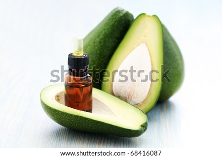 bottle of avocado essential oil with fresh fruit - beauty treatment