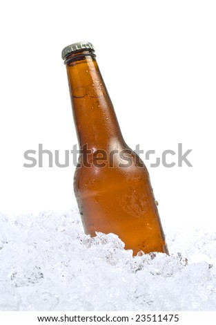 Bottle of beer resting on a bed of ice - stock photo