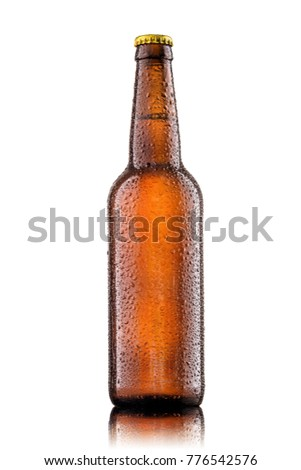 Bottle of beer with drops on white background. #776542576