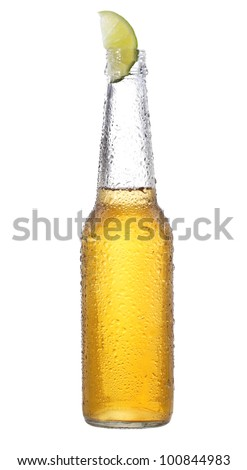 bottle of beer with lime on white background