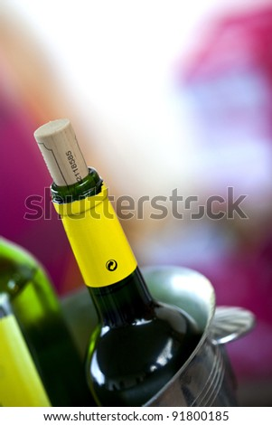 Bottle of Bordeaux wine in a bucket