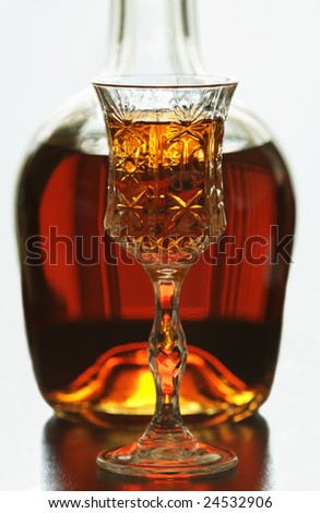 Bottle of brandy and glass