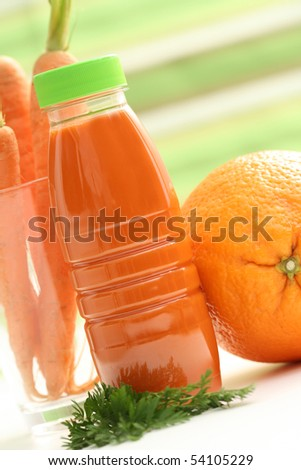 bottle of carrot and orange juice with fresh fruits - food and drink