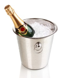 Bottle of champagne in bucket isolated on white