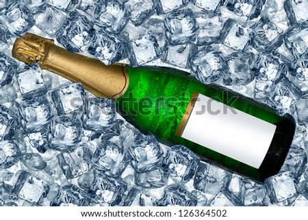 bottle of champagne on ice cubes