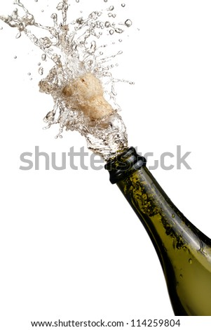 bottle of champagne popping its cork and splashing