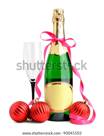 Bottle of champagne, wineglass and Christmas balls isolated on white background