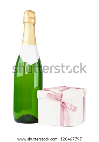 Bottle of champagne with Christmas present box isolated on white