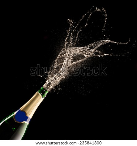 Bottle of champagne with splash isolated on black background #235841800