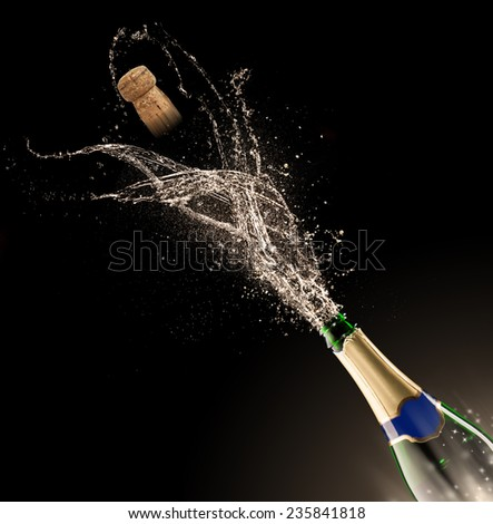 Bottle of champagne with splash isolated on black background #235841818