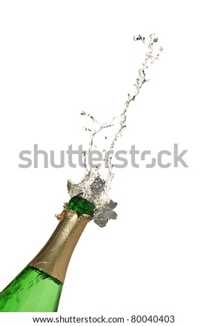 Bottle of champagne with splashes over white background